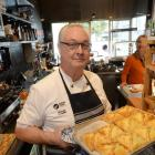 Michael Coughlin with one of his new cafe creations, beef cheek pies for The Fix. Photo: Linda Robertson.