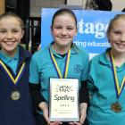 Pupils of Cromwell's Goldfields Primary School Grace White (11, left), Samantha Varcoe (11) and Zoe Laws (10) spelled only one word wrong to become year 5 and 6 champions. Photos: Jono Edwards