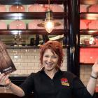 Cobb & Co Dunedin general manager Ange Copson with one of the new Dunedin restaurant's menus. Photos: Peter McIntosh