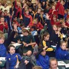 Year 5 and 6 pupils throw their arms in the air in the hope they will be picked to give an answer during an informal part of the Extra! Otago regional spelling quiz at Tahuna Intermediate yesterday. Photos: Peter McIntosh