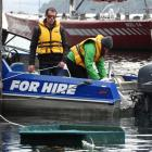 Queenstown businessman Max Perkins and Department of Conservation community ranger Nicole...
