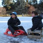 Tom (7) and Eddy (5) Smale, of Lauder, are towed over the ice. Photos: Jono Edwards