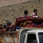 Syrian refugees on the back of a truck at Lebanon's border region of Arsal last week. Photos: Reuters