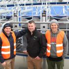 Southern Dairy Hub business manager Guy Michaels (left) and farm manager Jason Phillips with Southern Dairy Development Trust chairman Tony Miles in the milking shed of the new facility during the official opening on Friday. Photos: Petrina Wright