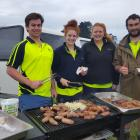Handy Landys members (from left) Mac Thomson, Holly Smith, Jess Hill and Tim Craig cook a barbecue on the day of the tree planting in Kaikoura for all the volunteers. The food was sponsored by the Handy Landys Club. Photos: Handy Landys
