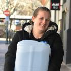 The Perc Cafe chef Rachel Hellyer carries a 20-litre container of water back to the business from the Octagon. Photos: Peter McIntosh