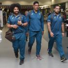 Wallabies forwards (from left) Tatafu Polota-Nau, Lopeti Timani and Tetera Faulkner walk through Dunedin Airport during a low-key welcome for the team last night. Photos: Gregor Richardson