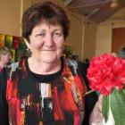 Maungatua spring flower show co-organiser Denise Chaplin with her rhododendron that won the award...