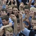 Labour leader Jacinda Ardern is mobbed by Taieri College pupils during a visit to the school...
