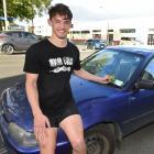 Dunedin student Scott Bezett (20), and his damaged car. Photos: Gregor Richardson