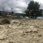 Parts of the main street in Roxburgh were still heavily covered in sludge yesterday, even though...