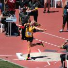 Zharna Beattie (15) gives it her all in her silver medal-winning throw during the junior girls...
