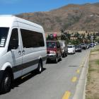 Traffic along Ardmore St beside Wanaka's lakefront was either gridlocked or could only crawl as the town struggled to cope with the influx of New Year revellers on the move. Photos: Kerrie Waterworth