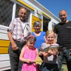 Brooke McIntyre (8) shows off the fish she caught in the Clutha River to her sister, father and grandparents (from left) Jonny, Jaclyn (5) and Margaret and Scott McIntyre at the Millers Flat Holiday Park. Photos: Pam Jones