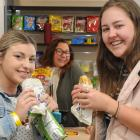 Campus Wonderful Store manager Simone Omipi (middle) serves hungry students Brenna Edmonds (left) and Sian Sunckell. Photo: Christine O'Connor