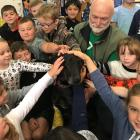 "Outram School children surround Meg ""the megadog'' and Andy Cunningham during their visit on..."
