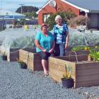Robyn Bell (left) and Beatrice Pratt amid some of the garden's 22 raised beds. Photos: Gillian Vine