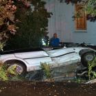 Two teens allegedly crashed into a Land Rover in Tomahawk Rd yesterday morning. Photos: Stephen...
