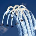 The Yak 52 team paint patterns in the sky as they perform in the feisty Russian trainer aircraft.