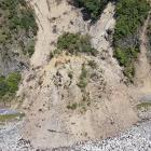 Queenstown may be isolated after a major rupture of the Alpine Fault by landslips like this one, which blocked State Highway 1, north of Kaikoura, in 2016. Photo: Mark Mitchell