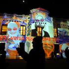 Queenstown media celebrity Scoop (Philip Chandler) stands in front of a surprise projection of...