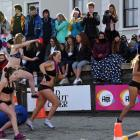 Go girl, go . . . The crowd looks on as the womans Undie 500 is run.