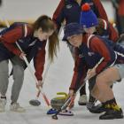 Kavanagh College curlers (from left ) Emily Armstrong , Jayden Bishop and Elizabeth Audas sweep...