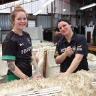 Once it's off the sheep, Molly Tapuke (left) and Amy Ferguson make sure there is nothing caught...