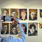 King's High School art teacher Lucia Rozenburg takes a photo of her pupils' artwork on display at...