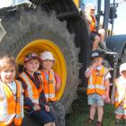 Rakaia Playcentre children and siblings Savarnah Crawley (2), David Scott (5), Billie Wiseman (4), Josh Green (5, up top), Jax Page (3), and Ben Scott (1), get up close to the JCB Fastrack tractor at the Townshend Agricultural Contracting site. Photos: To