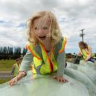 Sage McCurdy (aged 2), of Dunedin, plays on a  haybale caterpillar during a Fonterra Open Gates...