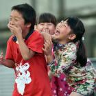 Performers leaving the stage (from left) Zhiqing Li (6), Natasha Birchall (6) and Siyao Zhu (6) erupt in fits of giggles during Chinese New Year celebrations at the Dunedin Chinese Garden in February. Photo: Peter McIntosh