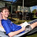 Chilling out in a hammock at the family crib in Karitane is Paddy Borthwick (17) of Dunedin....