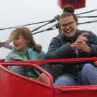 Megan Graham and her daughter, Jodie (8), enjoy the Octopus ride at the 105th Winton A&P Show....