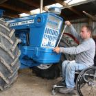 Stirling vintage machinery enthusiast Brendon Storer makes final adjustments to his recently restored 1974 Ford Country 754 tractor, which he drove down to Edendale yesterday. Photos: John Cosgrove