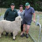 Anita Erskine (left) went all the way from Tuatapere to buy this ram bred by Rolleston farmers Karen and Leo Ponsonby for $610. Photos: Sally Brooker
