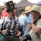 The Dunedin Steampunk Society stall, hosted by James Bryan, proved irresistible for English...