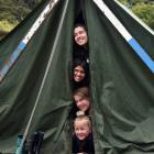 Huddling in their tent at Waiora Scout Camp are Brighton-based scouts (from top) Grace-Anne Patel...
