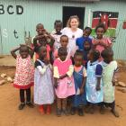 Zoe Dawson is surrounded by children taking part in the Children of Maasai Educational Programme...