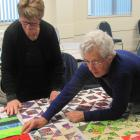 Isabell Page (left) and Joan Henderson, of Netherby WI, plan the design of one of the five bed quilts being made for St John's sleeping quarters in Ashburton. Photos: Toni Williams