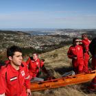 Dunedin Red Cross search teams look for survivors of a notional plane crash in the hills above...