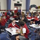 Competitors get down to business in the Otago Daily Times Extra! current events quiz at Bathgate Park School, in Dunedin, last night. Photos: Gregor Richardson