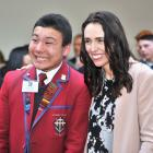 Kavanagh College pupil Sebastian Hook cracks a smile while having his picture taken with Prime...