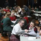 Pupils from around Dunedin and further afield flick through copies of the newspaper during the Otago Daily Times Extra! current events quiz for year 9 and 10 pupils yesterday. Photos: Linda Robertson