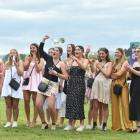 Supporters cheer on their favourites at the Fashions in the Field event at Wingatui. PHOTOS:...