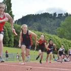 The first leg of an under-13 girls 200m relay heat. PHOTOS: GERARD O'BRIEN