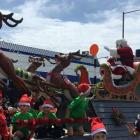 Santa Claus waves to the crowd at the end of last year's Kaiapoi Santa Parade. Photos: Supplied