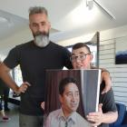 Artist Stephen Martyn Welch with his son Scott and his portrait of Paul Tamati.  PHOTO: MARK PRICE