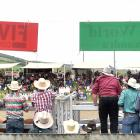 Cowboys line the fence at the Millers Flat Rodeo for the best view of the second division saddle...