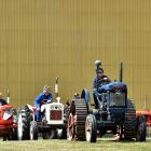Gerard Sheat, of Palmerston, drives a 1950 Fordson Major while leading the tractors in the grand...